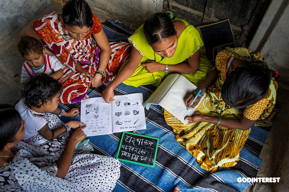 Asia: Manju is teaching several women how to read and write in a literacy class hosted in the women's house in 2011